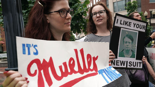 Activists hold signs — one referencing special counsel Robert Mueller — outside the Alexandria, Va., courthouse as Manafort's trial began this week.