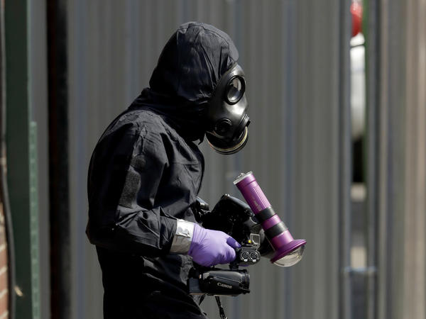 A specialist team member in a police protective suit in Salisbury, England, last month. British police scoured sections of Salisbury and Amesbury in southwest England, searching for a container feared to be contaminated with traces of the deadly nerve agent Novichok.
