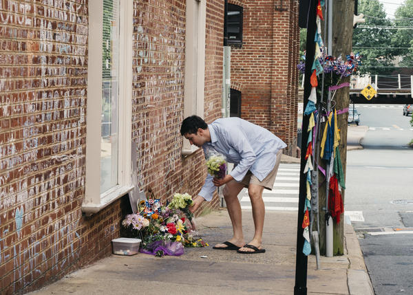 Peter Reijmers, 29, of Charlottesville, lays flowers at a memorial on 4th Street SE where Heather Heyer was killed last August.