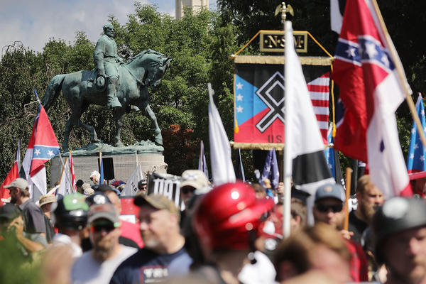 "The statue of Confederate General Robert E. Lee stands behind a crowd of hundreds of white nationalists, neo-Nazis and members of the ""alt-right"" during the ""Unite the Right"" rally August 12, 2017 in Charlottesville, Va."