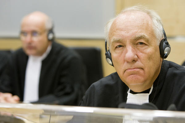 Then-Chief Prosecutor Stephen Rapp (right) is seen at the U.N.-backed Special Court for Sierra Leone in The Hague, Netherlands, in 2009. He says there's even more evidence against the Assad regime than the successful war crimes tribunals for Rwanda and Sierra Leone.