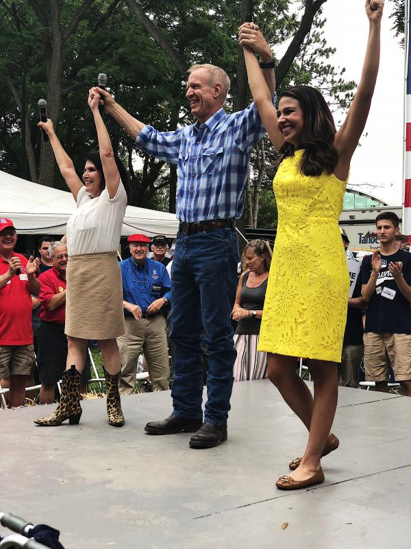 Republicans held their annual rally at the Illinois State Fairgrounds in Springfield Wednesday with a message of party unity. Photo: Lt. Gov. Evelyn Sanguinetti, Gov. Rauner & AG candidate Erika Harold during Governor's Day rally September 15, 2018.