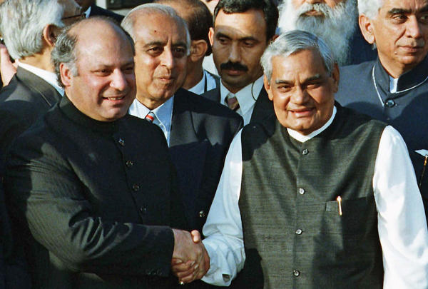 In this February 1999 photo, Pakistani Prime Minister Nawaz Sharif (left) is seen receiving Indian Prime Minister Atal Bihari Vajpayee at the Wagah border near Lahore, Pakistan.