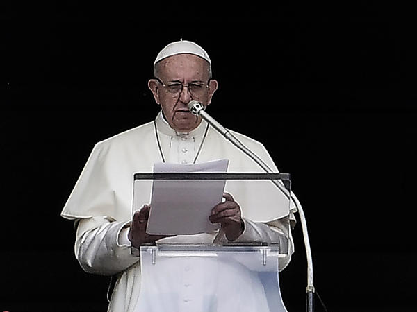 Pope Francis reads from the window of his studio overlooking St. Peter's Square at the Vatican on Wednesday. On Thursday, the Vatican responded to the latest report of clergy abuse in the United States.