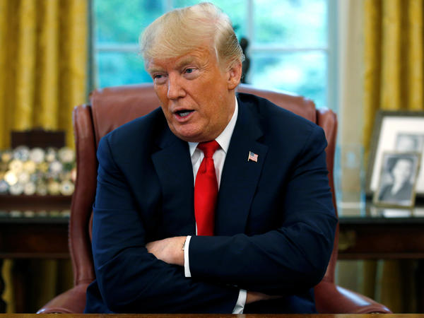 President Trump answers a question during a Reuters interview in the Oval Office on Monday. The president again criticized the Fed for raising interest rates.
