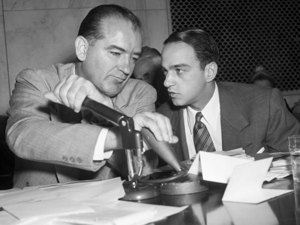 Sen. Joseph McCarthy listens to his attorney, Roy Cohn, during the televised Army-McCarthy hearings in 1954. The series of hearings badly damaged the senator's image and led to a vote of censure by the Senate.