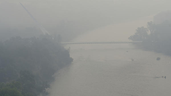 An aerial view shows the smoke and limited visibility caused by a wildfire earlier this month in Redding, Calif.