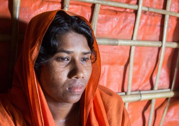 Dildar Begum, 30, in her shelter in the Hakimpara Rohingya refugee camp in Bangladesh. She says 29 members of her extended family were killed a year ago in what the U.S. has said was a campaign of ethnic cleansing by the Myanmar military.