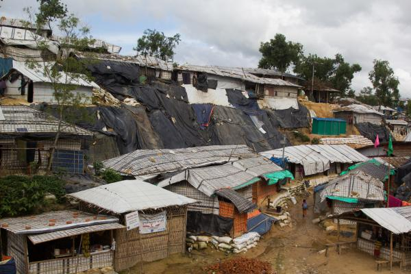 Tarps have been draped over steep sand cliffs in the Balukhali Rohingya refugee camp in Bangladesh to keep them from collapsing.