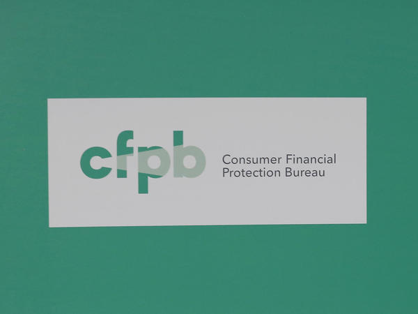 President Obama visits the Consumer Financial Protection Bureau in 2014.