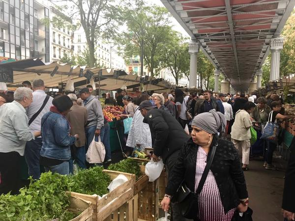 Shoppers are out in force in August at the Barbes market.