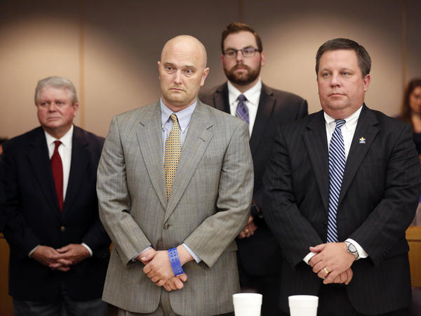 Former Balch Springs Police Officer Roy Oliver (foreground left) stands next to defense attorney Miles Brissette (right) after being sentenced Wednesday to 15 years in prison for the murder of 15-year-old Jordan Edwards.