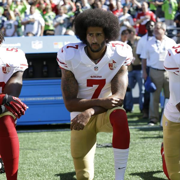 San Francisco 49ers' Colin Kaepernick kneels during the national anthem before an NFL football game against the Seattle Seahawks, in Seattle, in September 2016.