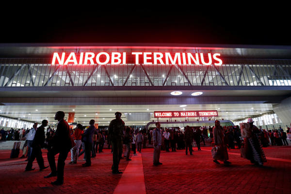 "Red neon announces the ""Nairobi Terminus"" at the Chinese-financed Standard Gauge Railway station in Kenya's capital."