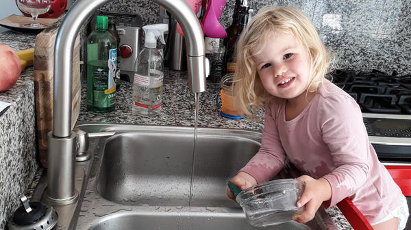 Rosy does dishes — voluntarily. Getting the 2-year-old involved in chores did lead to the kitchen being flooded and dishes being broken. But now she is still eager to help.