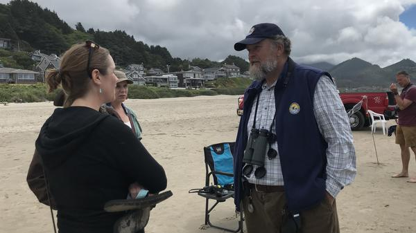 Art Broszeit, a volunteer for the Department of Interior, enjoys meeting beachgoers and talking about birds and ocean science.