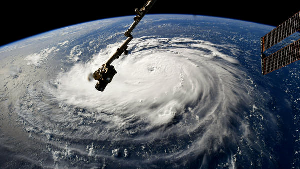 Hurricane Florence, as seen from the International Space Station on Monday, gains strength in the Atlantic Ocean as it moves west.