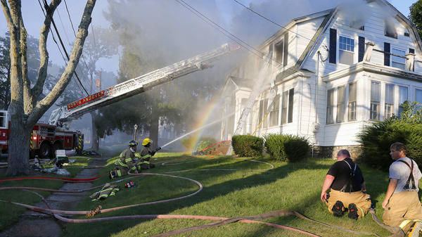Firefighters battle a house fire in North Andover, Mass., one of a series of fires and explosions on Thursday thought to have been triggered by a gas line that feeds several communities north of Boston.