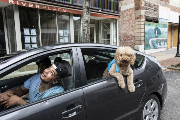 Brandon Mendoza, Lonis Hernandez and Charlie, drive around capturing signs of Hurricane Florence in Wilmington, N.C., on Thursday.