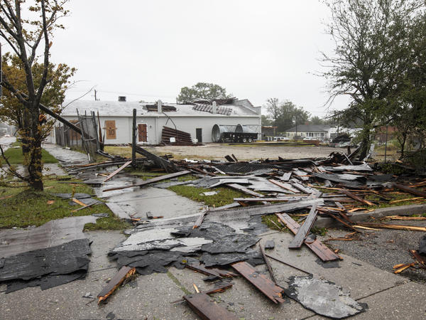 Debris from a nearby rooftop shows the force of Tropical Storm Florence's wind gusts in Wilmington, N.C., on Friday.