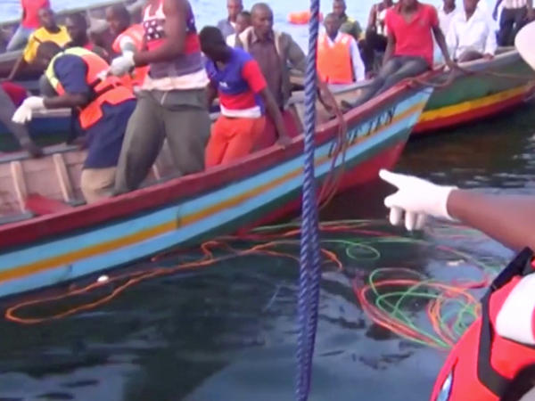 Rescue workers are seen on Friday at the scene where a ferry overturned in Lake Victoria, Tanzania.