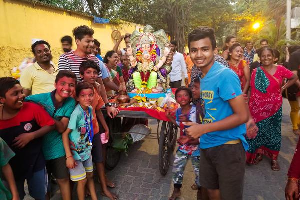 Revelers in Mumbai hoist up a statue of the elephant-headed god Ganesh and parade it toward the Arabian Sea.