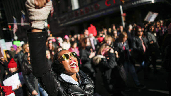 A woman shouts slogans during the Women's March in New York City, January 20, 2018, as protestors took to the streets en masse across the United States. It was a sign of lasting outrage, coming a year after the first women's marches following President Trump's inauguration.