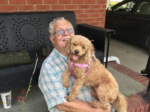 """Jerry Gray with his dog, Zoe, whom he also calls Sweetie and Hard Head. Zoe was the only pet his deceased wife, Hilda, would allow in their house. After losing his wife — and now his house — Gray says Zoe means everything to him. """"If I lost her, forget it,"""" he says."""