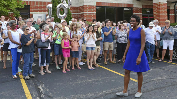 In this July 29, 2018, photo, rookie Democratic candidate Lauren Underwood greets supporters at the opening of her campaign office in St. Charles, Ill., 100 days before the midterm election.