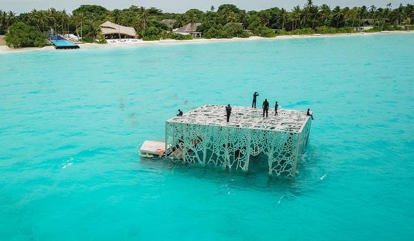 British artist Jason deCaires Taylor's <em>Coralarium</em> sits in waters off the Maldives.