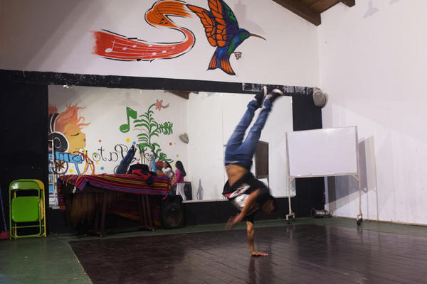 "Jonathan Ramirez, 16, breakdances at Los Patojos. ""We have four fundamentals here,"" says Rafael Fuentes, the education coordinator, ""food, health, education and art. For us, art is just as important as math."""