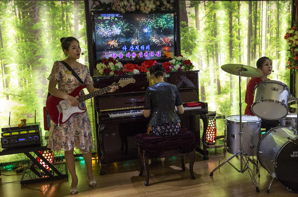 A house band performs a lunchtime set at an Italian restaurant in Pyongyang. North Korean leader Kim Jong Un is regarded as ushering in an era of comparatively relaxed fashion, hairstyles and popular culture.