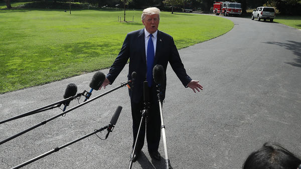 President Trump speaks to the media before leaving the White House to speak with electrical workers in Philadelphia.