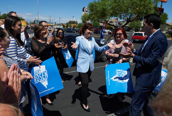 Rep. Jacky Rosen (center), the Democratic U.S. Senate candidate in Nevada, greets supporters ahead of early voting at Cardenas Supermarket in Las Vegas on May 26.