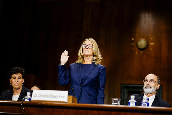 Kavanaugh accuser Christine Blasey Ford is sworn in before testifying Thursday at a confirmation hearing for the Supreme Court nominee.