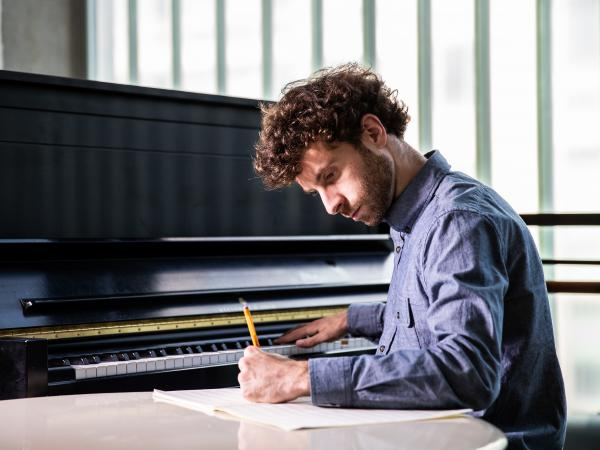 "Matthew Aucoin, 28, has been awarded a MacArthur ""genius"" grant for his work as a composer and conductor."