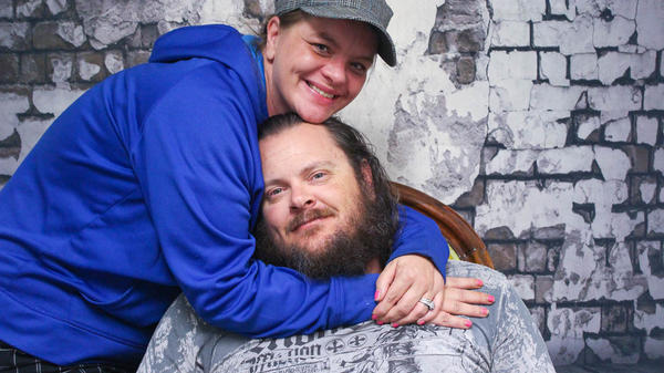 Jamie Topping embraces Duane Topping during their StoryCorps interview in May, at their Denver-based studio.