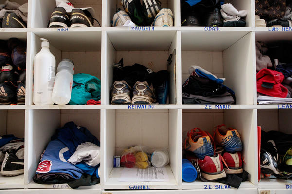 Clothes and shoes in the locker room at Desportivo Brasil.