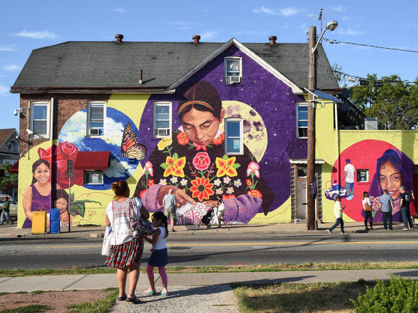 A public mural in New Brunswick, N.J., made by Layqa Nuna Yawar in collaboration with the Esperanza Neighborhood Project.