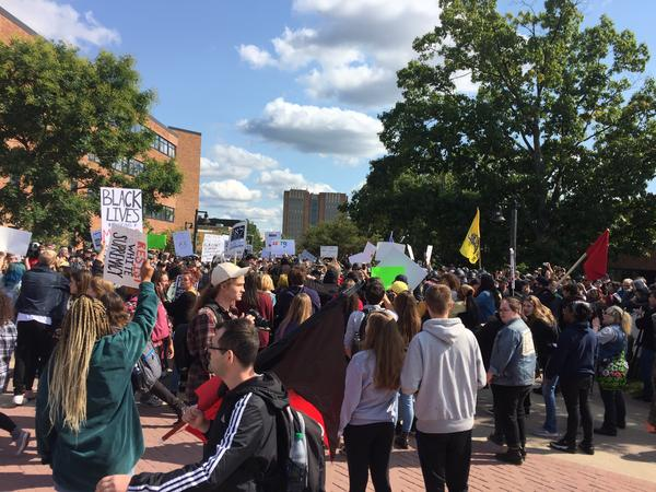 Protestors, police and open carry walkers verbally clashed in front of Sattefield Hall on Saturday, stopping the open carry walk for close to an hour before organizers headed back to their cars.