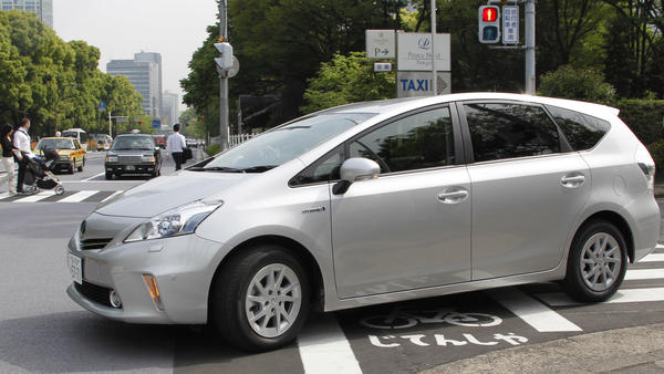 Toyota says it will use a software update to fix an issue with some Prius models, saying certain conditions could result in their unexpectedly stalling. Here, a Prius is seen during a test drive in Tokyo in 2011.