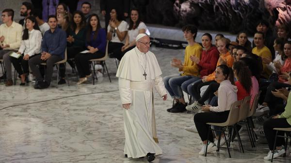 Pope Francis leaves the Paul VI hall at the end of his meeting with youths attending the synod at the Vatican on Saturday. The three-week meeting will likely be dominated by what many analysts call Catholicism's worst crisis since reformation.