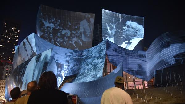 "The site-specific art installation called ""WDCH Dreams"" by media artist Refik Anadol is projected onto the undulating stainless steel facade of the iconic Walt Disney Concert Hall in Sept. 2018 in Los Angeles."