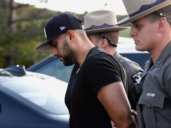 Nauman Hussain is brought into Cobleskill Town, N.Y., court for arraignment Wednesday.