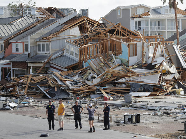 Rescue personnel search for people who may need help in Mexico Beach, Fla., on Thursday, one day after Hurricane Michael made landfall near the area.