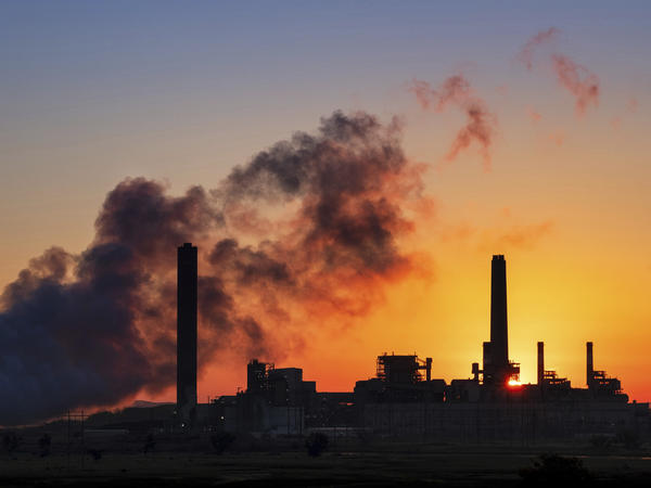 The Dave Johnson coal-fired power plant against the morning sun in Glenrock, Wyo. Democrats in some midterm swing races are targeting the Trump administration's environmental rollbacks and climate denial.