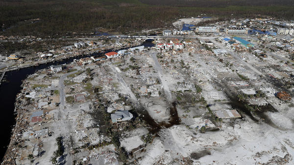 Florida's hurricane-devastated communities, such as Mexico Beach, are struggling to recover, partly because of poor cellphone service.