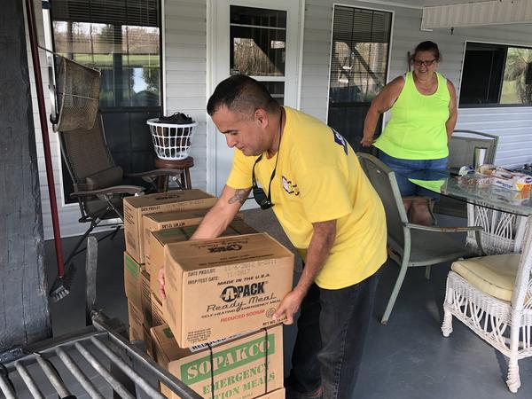 Volunteer rescuer George Ruiz visits Roxy Melvin in rural Alford, Fla. Roxy's cousin in Alabama contacted the website CrowdSource Rescue because she couldn't get in touch with Roxy and her father. Ruiz made a wellness check 8 days later and delivered supplies.
