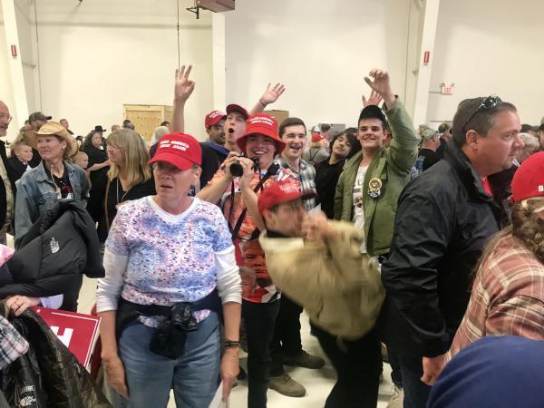 A group of Trump rally attendees mimic bodyslamming CNN reporter Jim Acosta.
