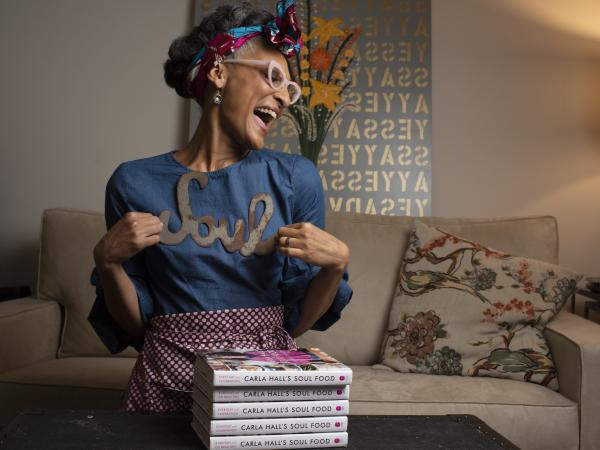 Carla Hall has a new book that explores her heritage and  attempts to bring soul food to a wider audience. She embarked on a long journey through the South to investigate and get inspiration, and the story is a deep look into her philosophy.